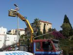 Installing repeaters on a lamp post for optimal signal reception
